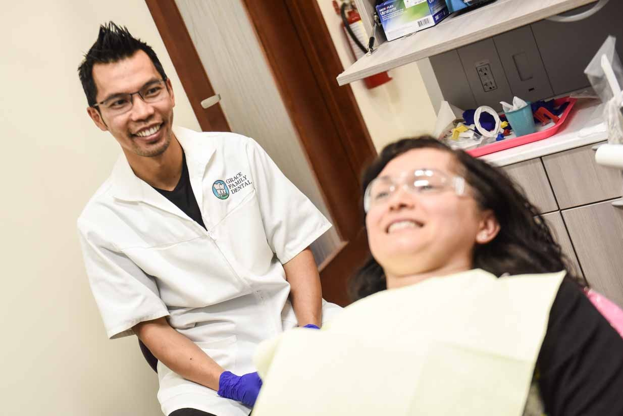 Dr. Quach and Smiling Patient | Grace Family Dental | Airdrie Dentist